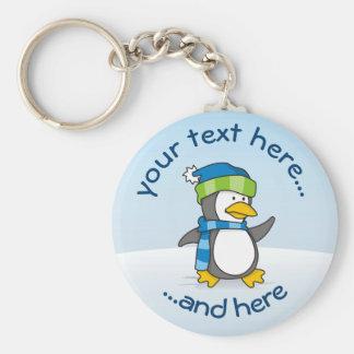 Little penguin walking on snow key ring
