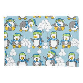 Little penguin with snow balls waving pillowcase