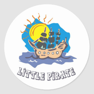 Little pirate toddler on a sailboat on the sea round sticker
