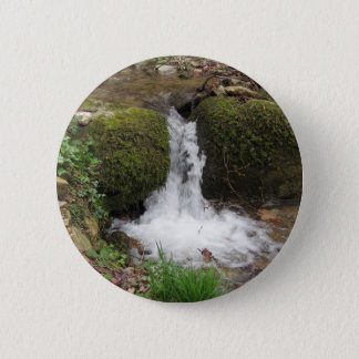Little waterfall by mossy rocks in the forest 6 cm round badge