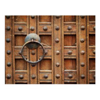 Locked wooden gate postcard