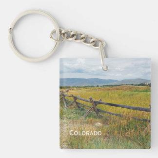 log fence by a prairie key ring