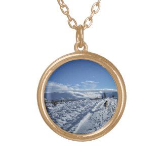 Lone dog in snow road pendants