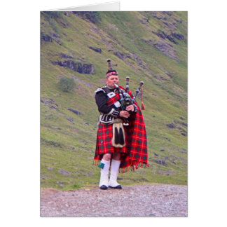 Lone Scottish bagpiper, Highlands, Scotland Card