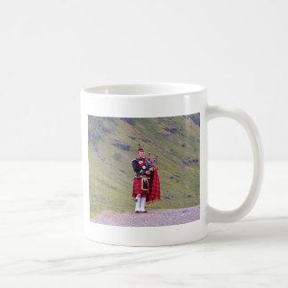 Lone Scottish bagpiper, Highlands, Scotland Coffee Mug