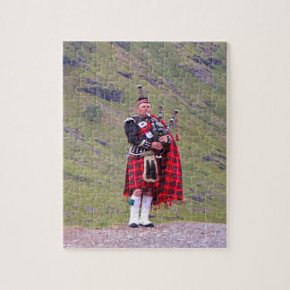 Lone Scottish bagpiper, Highlands, Scotland Jigsaw Puzzle