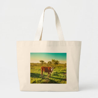 Lonely Cow in the Meadow Facing the Camera Large Tote Bag