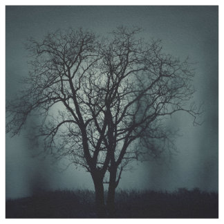 Lonely dead tree at night fabric