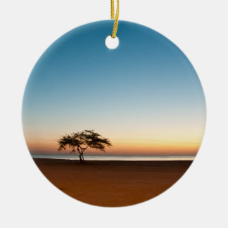 Lonely tree at sunrise in Kuwait Ceramic Ornament