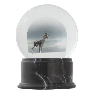 lonesome reindeer snow globe