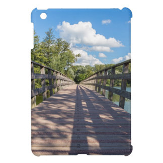 Long wooden bridge over water of pond case for the iPad mini