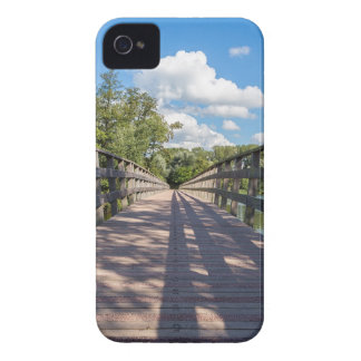 Long wooden bridge over water of pond iPhone 4 cover