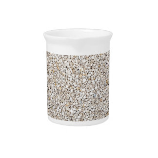 Lot of grey gravel stones as background pitcher