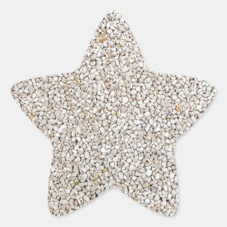 Lot of grey gravel stones as background star sticker
