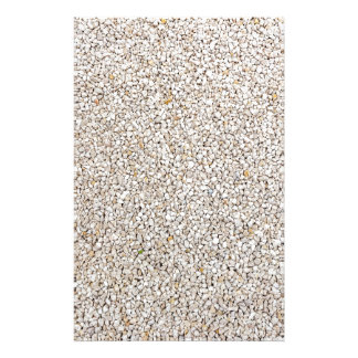 Lot of grey gravel stones as background stationery