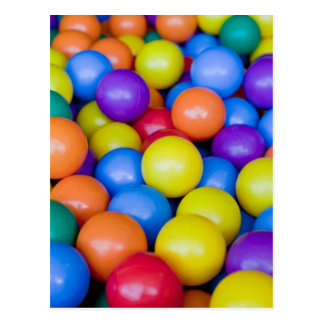 Lots of colorful plastic balls post card
