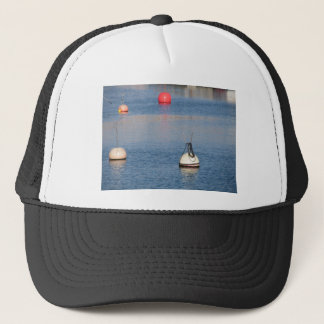 Lots of mooring buoys floating on calm sea water trucker hat