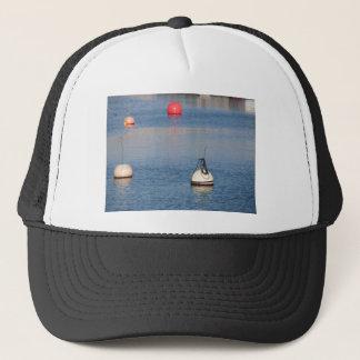 Lots of mooring buoys floating on calm sea water trucker hat
