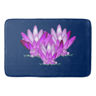 Lotus blossom pink on navy blue background bath mat
