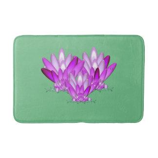 Lotus blossom pink on sea green background bath mat