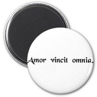 Love conquers all. 6 cm round magnet