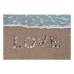 Love on the beach posters