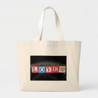 Love spelled out in Baby Blocks & black background Jumbo Tote Bag
