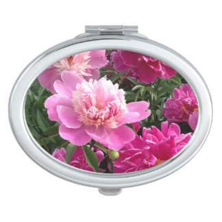 Lovely mirror adorned with pink peonies travel mirror