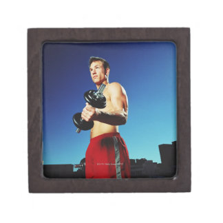 low angle of a man in shorts working out with a premium trinket box