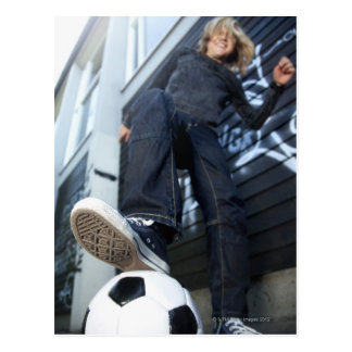 low angle portrait of blond boy with football postcard