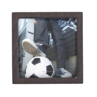 low angle portrait of blond boy with football premium trinket box