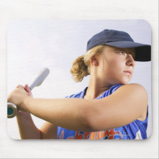 Low angle side view of a softball player looking mouse pads