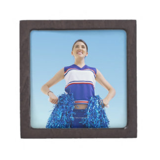 Low angle view of a cheerleader holding her premium gift box