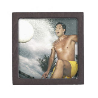 Low angle view of a man playing beach volley premium keepsake box