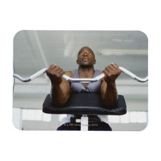 Low angle view of a mid adult man exercising in rectangular photo magnet