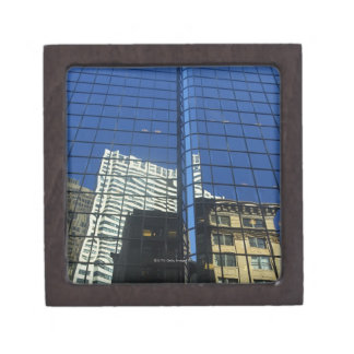 Low angle view of the reflection of buildings on premium trinket boxes
