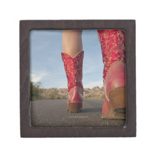 Low-angle view of woman wearing cowboy boots premium gift box