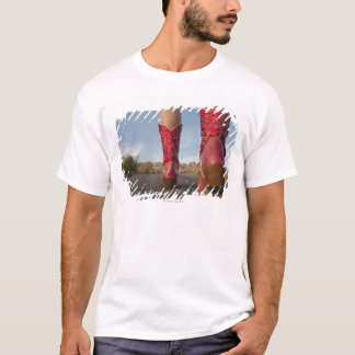 Low-angle view of woman wearing cowboy boots T-Shirt
