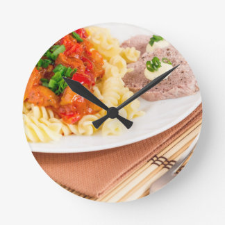 Lunch dish of Italian pasta, vegetable sauce Round Clock