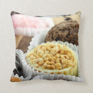 Luxury individual chocolates in cases closeup throw pillows
