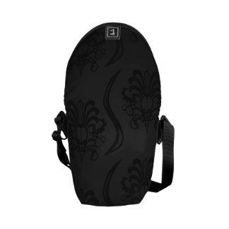 Luxury of ornamentation in black commuter bags