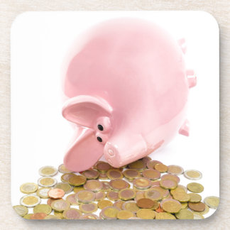 Lying pink piggy bank with pile of euro coins beverage coaster