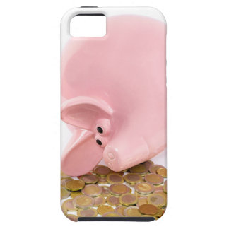 Lying pink piggy bank with pile of euro coins iPhone 5 case