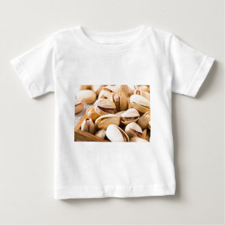Macro close-up view of a group of salted pistachio baby T-Shirt