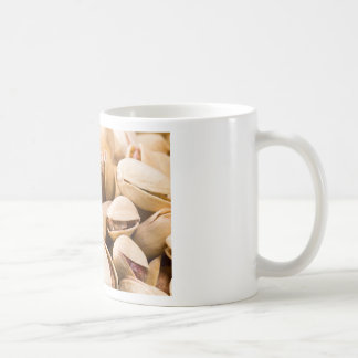 Macro close-up view of a group of salted pistachio coffee mug