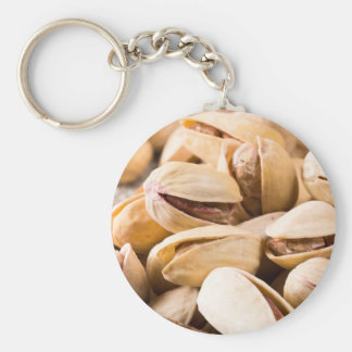 Macro close-up view of a group of salted pistachio key ring