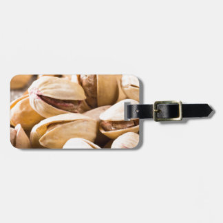 Macro close-up view of a group of salted pistachio luggage tag