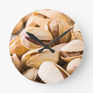 Macro close-up view of a group of salted pistachio round clock