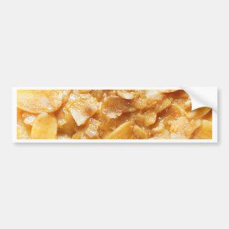 Macro of almond splitters on a cake bumper sticker