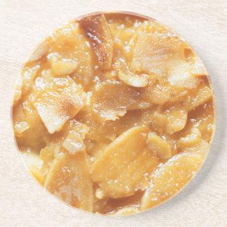 Macro of almond splitters on a cake coaster